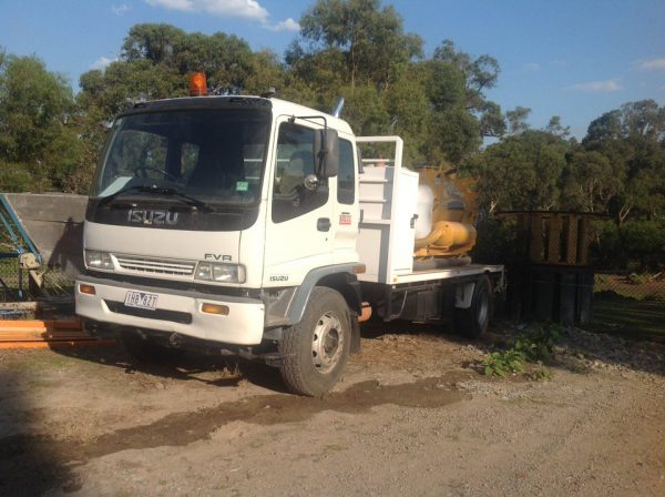 1998 Isuzu FVR 950 with Vermeer Ring O Matic 3